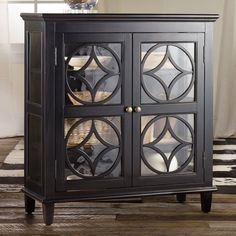 Gorgeous Black and Glass Storage Cabinet. Maybe paint it a bright color?