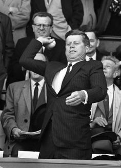 "1962, President John F. Kennedy throws out the ceremonial first pitch in Washington D.C.'s new stadium, called simply ""D.C. Stadium."""