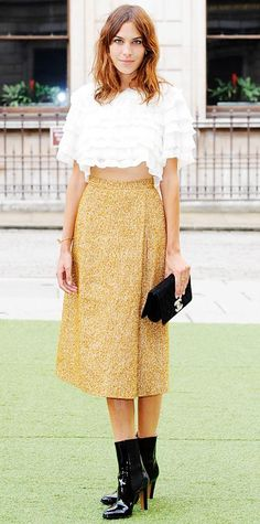JUNE 5, 2014 Alexa Chung hit the Royal Academy Summer Exhibition Preview Party in a white ruffled crop top and straw-colored tweed midi skirt, both by Chanel dress, complete with a black clutch and patent black boots.