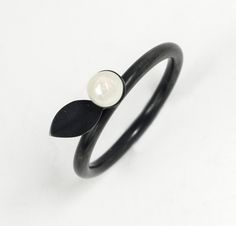 Oxidised silver flower bud ring on stem with leaf and freshwater pearl £119.00