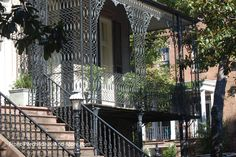 Artistic wrought iron columns and railings. From Front-Porch-Ideas-and-More.com  #porch #columns