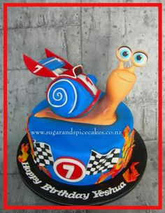 "Turbo Snail Cake ""No dream is too big, and no dreamer is too small."" I loved making this little guy! He wasn't little though – stood 9.5 inches high and is made from fondant and Rice treats. Cake is 11inches. Thanks for looking!"