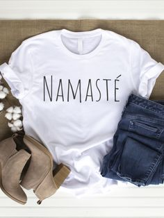 "Jiyú Soul - free your potential ...  White or Gray Shirt with Saying:   Namasté is a greeting gesture from Nepal and means ""I greet the divine in you""  In everyday life we often overlook the special and forget that there is something divine in everything. Let us appreciate the things around us more!   he T-shirt can be used as a yoga shirt and is also great for everyday use. It is very easy-care and can be washed at 30-40 degrees. To protect the print wash on the left side. Grey Shirt, T Shirt, Shirts With Sayings, Namaste, Sustainable Fashion, Gifts For Friends, Custom Shirts, Shirt Designs, Nepal"