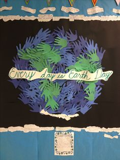 Earth Day Bulletin Board made of student traced hands and surrounded by student statements of advice to protect the earth.