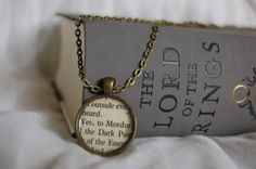 Lord of the Rings bookpage necklaces!!     I found this really awesome Etsy listing at https://www.etsy.com/listing/206775426/lord-of-the-rings-to-mordor-bookpage