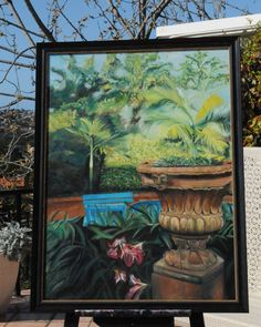 One of my paintings entitled 'Tropical Paradise' - a scene from our Brisbane backyard showing a teracotta urn and blue timber seat overlooking the palm trees.