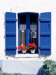 Bleu de Bretagne   par phibu. Fenêtre avec volets en bois de couleur bleu et pots de fleurs.