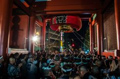 Asakusa Sanja Matsuri 3rd day 12/22 The Ninomiya omikoshi stops before Kaminarimon gate and the chiefs of the hikeshi/firemen are giving the signal so it can start again, this time up Nakamise Dori/Street. The omikoshi must pass very quickly under the gate so this is always a dangerous moment for the hundreds of bystanders lining the narrow commercial street! #Asakusa, #Sanja, #Matsuri, #omikoshi, #Kaminarimon, #Ninomiya, #Nakamise Taken on May 18, 2014. © Grigoris A. Miliaresis