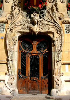 Art Nouveau Style, Paris. I have a thing for doorways. I didn't recognize that fact until now, but I've always liked doors (fancy ones in particular), gates and windows -- the structures that delineate and define spaces -- especially the private from the public. Hmmm... wonder what Freud would say? Never mind, don't care what he would say. :)