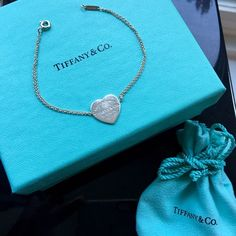 """Tiffany & Co. """"Please Return"""" Heart Bracelet Tiffany & Co. """"Please Return"""" Heart Bracelet. 100% authentic (as all my listings are). Previously owned but in great condition. Clasp and chain are original and still work perfectly. Comes complete with box and dust bag. Tiffany & Co. Jewelry Bracelets"""