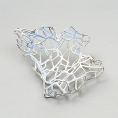 Carolina Gimeno - Brooch. Copper, enamel, silver. Picture from http://kitandcaboodle.ning.com