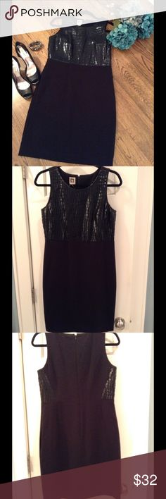 Anne Klein little black dress with faux leather Sleeveless black dress with black faux leather pebble design on top.  Be ready for holiday cocktail hour or parties with this dress! Anne Klein Dresses