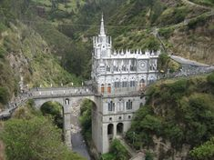 Santuario de Las Lajas is a basilica situated in Department of Nariño, Colombia, built inside the canyon of the Guáitara River. The church is of Gothic revival architecture and was built from 1916 to Beautiful Places To Visit, Beautiful World, Places To Travel, Places To See, Gothic Revival Architecture, Famous Castles, Les Religions, Cathedral Church, Chapelle
