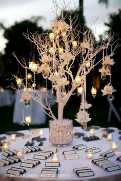 seating card table with a white tree and hanging candles & floral wedding tables candles 100 Insanely Creative Seating Cards and Displays Wedding Table, Diy Wedding, Wedding Flowers, Floral Wedding, Wedding Card, Xmas Wedding Ideas, Wedding Favors, Wedding Seating Cards, Wedding Banners