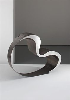 RON ARAD 'Sit!' chair, c. 1990  Mirror-polished stainless steel, tempered sprung steel. 92 cm (36 in) high  Produced by The Gallery Mourmans, The Netherlands. Number 17 from the edition of 20 plus five artist's proofs. Side incised with '17 / 20 Ron Arad'.