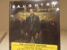 """BRAND NEW. This Deluxe Edition of Daughtry's debut album has 4 new bonus tracks including """"Feels Like The Very First Time"""" and a DVD featuring all 5 #Daughtry videos. Live performances, interviews and more. Never opened! At your door for only $7.99 and you get free shipping too!"""