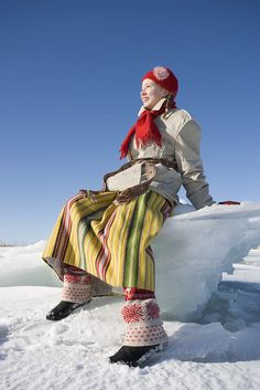 The Harjumaa maid in the winter outfit inspired by traditional costumes, Estonia