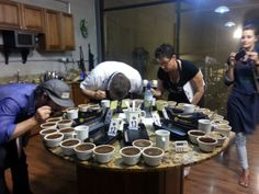 A cupping celebration in San Jose, Costa Rica. Mary is cupping to select which Costa Rican coffees she will purchase for Electric City Roasting Company. www.electriccityroasting.com