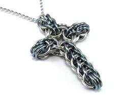 Black Ice Cross Necklace -  Celtic Style Chainmail Metal Cross Pendant. $13.00, via Etsy.