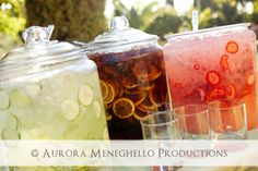 Welcome bar = cucumber water, ice tea, & strawberry lemonade... lovely color in glass jars