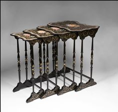 """Papier Mache Nesting Tables.  """"Henry Clay of Birmingham, England patented a process in 1772 of treating laminated sheets of paper with linseed oil to waterproof them, and Theodore Jennens patented a process in 1847 for steaming and pressing these laminated sheets into various shapes."""""""