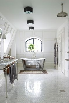 Marianne Brandi of Day Birger et Mikkelsen, has created an indulgent bathroom in her Copenhagen home. The wet room area - with its ceiling-mounted 'Nene' shower from Drummonds, gives an open plan feel, allowing the 'Usk' bath and 'Double Lowther' basin, also from Drummonds to take centre stage. We also love the contrast of paneled walls and marble moscaic floor.