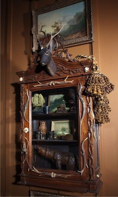 This small Black Forest cabinet is located just outside the bath and leads the way to the porch.