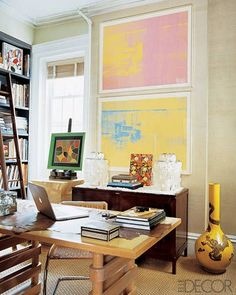 Bold doses of color with framed prints. Notice the storage right under it, and desk in the middle of the room. Photo Gallery of Home Offices – Elegant Home Offices and Luxury Home Offices - ELLE DECOR