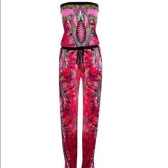 Custo Barcelona Jumpsuit Size 1 which is equivalent to a small/// slightly use but it is in good condition/// it will fit a person about 5'04 tall// offers accepted Custo Barcelona Other