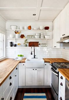 Love the sink, counter top, cabinets and cabinet pulls in this kitchen.