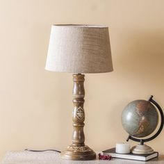 Choose from a vast range of Lighting Products like table lamps, pendant lamps, candle stands, lanterns & more. Floor Lamp, Table Lamp Wood, Luxury Table Lamps, Wooden Floor Lamps, Wooden Lamp, Vintage Lamps, Luxury Lamps, Handcrafted Lamp, Floor Lamp Design