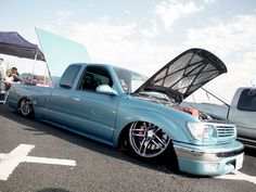 This JDM Toyota Hilux Pickup Truck is bagged low to the ground on a set of Advan AVS Model 5 JDM Wheels. This truck is clean and has a unique combination of parts and drivetrain. – JDM Truck: Advan AVS Model 5 on Toyota Hilux