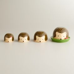 Hedgehog Measuring Cups. I know they are measuring cups but they would look so cute in the garden!!