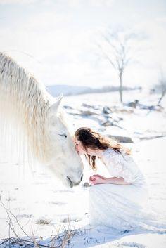 Brides kisses horse winter wedding | Saratoga Springs, NY wedding photographer