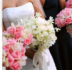 pink and white wedding bouquet roses mini cymbidium orchids