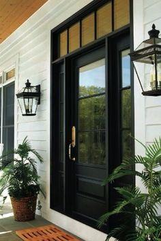 Black door and transom, sconces, planters http://utahdesignworks.blogspot.com