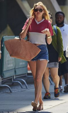 Street style: Swedish model Elsa Hosk was making the most of the sun on Friday as she disp...