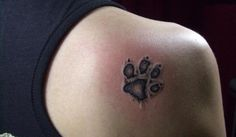 Dog Paws Tattoo....the details around the edges are really good on this one. It looks imprinted or raised in the skin