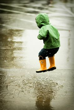 Puddle jumping in the rain never gets old.