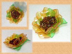 flowers from plastic bottles    http://www.microsofttranslator.com/bv.aspx?from==en=http%3A%2F%2Fwww.livemaster.ru%2Ftopic%2F36273-podsolnushki-iz-butylochnogo-plastika-bizhutariya%3Fmsec%3D2%3F