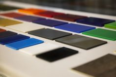 """A selection of materials illustrates the Oluce's """"bespoke tailoring"""" service."""