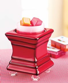 Our Red Square Footed Warmer wit a timer....set the timer with a one button touch, so it turns off automatically in 4, 8 or 12 hours:-) Save money, melt safe and smart http://www.kikiscandles.com