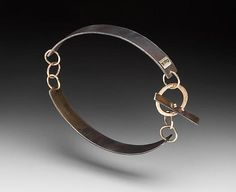 Toggle Bracelet by Peg Fetter: Gold and Steel Bracelet available at www.artfulhome.com