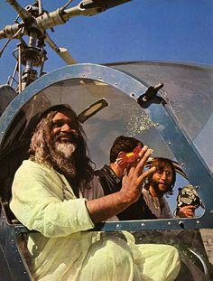 "Maharishi made use of helicopters, when necessary, but said ""they rattle the bones too much"" to be preferable.  Here His Holiness is accompanied by John Lennon."