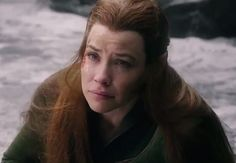 Tauriel is crying over something... << there is a wide-shot version of this photo in which you can see something lying across her lap - the visible end of which appears to be dwarves boots.