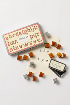 alphabet stamps look vintage-y and typewriterly and have degraded look from stamping process that looks hand-done