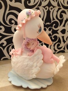 Cold Porcelain Stork with a Baby Girl.