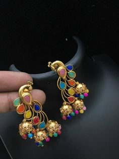 Beautiful peacock dancing peacock design earring with triple jumkhi hangings. Peacocks studded with multi color stones. Amrapali Jewellery, Indian Jewelry Earrings, Jewelry Design Earrings, Designer Earrings, Pendant Jewelry, Jewelery, Stud Earrings, Peacock Earrings, Golden Jewelry