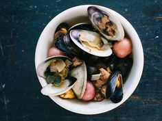 Chef Chris Fischer's version of a traditional New England clambake, with a spicy pork sausage broth.