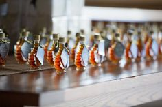 """Great idea! Maple Syrup Wedding Favor. Tag says, """"Hugs and kisses from the new Mr. and Mrs."""""""